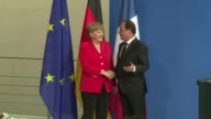 German Chancellor Angela Merkel and French President Francois Hollande urge speedy efforts for debthit Greece to reach a deal with its international...