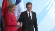 German Chancellor Angela Merkel appeared on Friday to give ground on her demands for private involvement in a new Greek rescue following talks in...