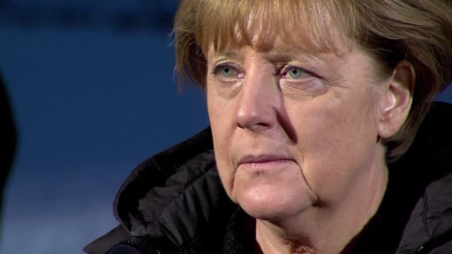 German Chancellor Angela Merkel came under mounting pressure Wednesday over her welcoming stance toward migrants which opponents have linked to a...