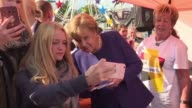 German Chancellor Angela Merkel meets with crowds in Stralsund Germany at a neighbourhood party organised by her party CDU a week before the German...