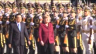 German Chancellor Angela Merkel reviews honor guards as she is welcomed by China's Prime Minister Li Keqiang in Beijing China on October 29 2015...