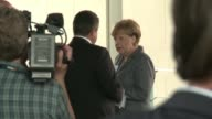 German Chancellor Angela Merkel says she is happy that Germany is now seen by many abroad as a place of 'hope