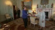 German Chancellor Angela Merkel shaking hands with Queen Elizabeth