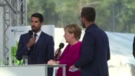 German chancellor Angela Merkel shows up at the open day of the Chancellery in Berlin with German football player Sami Khedira
