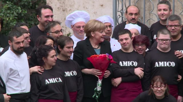 German Chancellor Angela Merkel visits the Community of SantEgidio in Rome ahead of her meeting with Pope Francis