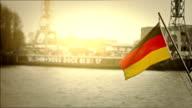 German flag at the harbor of Hamburg and Elbe river