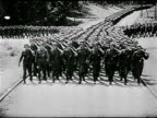 German Nazi Hitler saluting soft focus soldier FG Hess HA WS German Nazi soldiers marching down road nine abreast CU German Boots legs marching