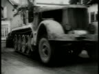 German Nazi soldiers on the move riding on road in motorcycles sidecars armored vehicle LA German halftrack truck large truck w/ roller wheels...