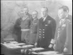 German prisoners including Alfred Jodl sign unconditional surrender papers / Walter Smith signs for allies/ Jodl speaks requesting mercy / General...