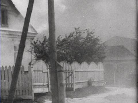 German soldiers enter a burning village