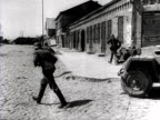 German soldiers fight in the streets of a village