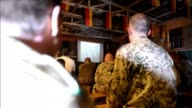 German soldiers with the NATO led International Security Assistance Force watched their side play Argentina on a giant screen broadcasting the World...