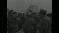 German warplanes parked in row on airfield / two shots of group of Allied officers waiting for German Field Marshal Wilhelm Keitel's arrival / small...