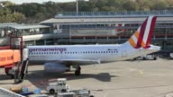A Germanwings GmbH Airbus A319100 aircraft operated by Deutsche Lufthansa AG is towed at Tegel airport operated by Flughafen Berlin Brandenburg GmbH...