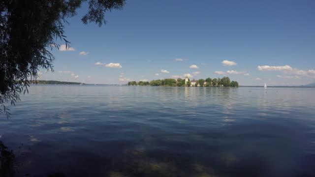 Germany, Bavaria, Lake Chiemsee, island Frauenchiemsee or Fraueninsel and sailboats