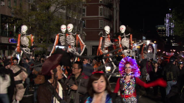 A Jägermeister float makes its way down the parade route as skeleton puppets dance in front of it