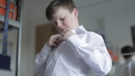 Getting Dressed for School - Boy Putting on his School Shirt