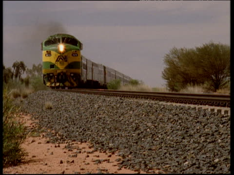 Ghan train travels towards camera Northern Territory