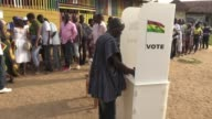 Ghanaians begin voting in an unpredictable presidential election that is being seen as a litmus test of stability in Africa's most secure democracy