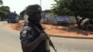 Ghanaians face an anxious wait for the results of a nail biting presidential election tainted by sporadic outbreaks of violence with no clear...