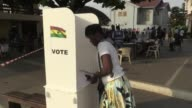Ghanaians queue to choose a new president between incumbent John Mahama and his rival Nana Akufo Addo in a tight race tainted by violence