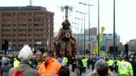 A giant deep sea diver puppet part of a street theatre production entitled Sea Odyssey took a stroll through Liverpool on Friday to mark the 100th...