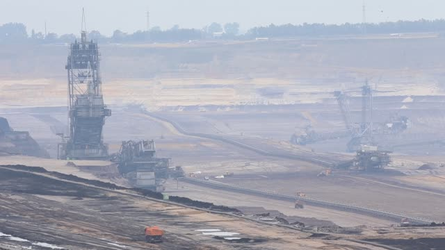 A giant excavator operates at an open pit lignite mine also known as brown coal operated by RWE AG in Hambach Germany on Monday Sept 7 2015