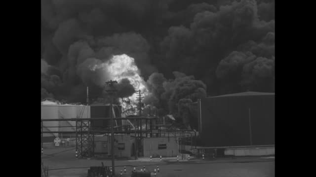 CU giant fireball at rail yard behind Union Pacific rail car as Standard Oil refinery fire continues / fire and smoke burn / Illinois Central rail...