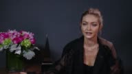INTERVIEW GiGi Hadid on cohosting this years AMAs with Jay Pharoah how she is preparing for the show how many outfit changes we can expect to see the...