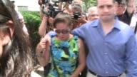Gilberto Valle holds his mother's hand as he walks out of the federal courthouse at 500 Pearl Street as a free man