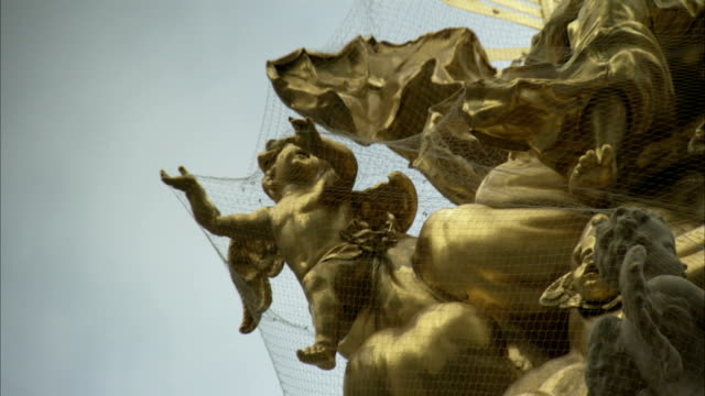 Gilded angel statues decorate the uppermost points of Hofburg Palace in Vienna. Available in HD.