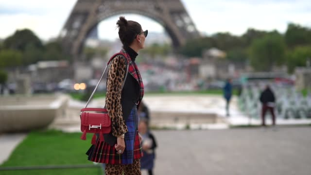 Giovanna Battaglia wears a tartan outfit with leopard print boots outside Hermes during Paris Fashion Week Womenswear Spring/Summer 2018 on October 2...