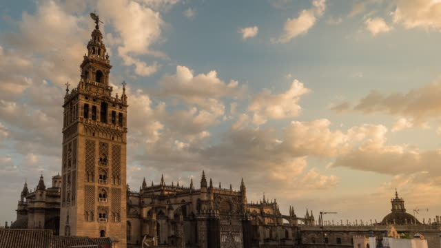 giralda cathedral in seville spain with clouds sunset timelapse