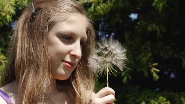 girl and dandelion
