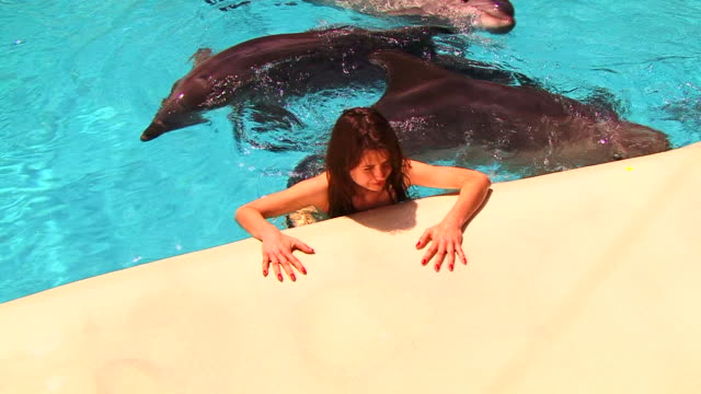Girl and dolphins