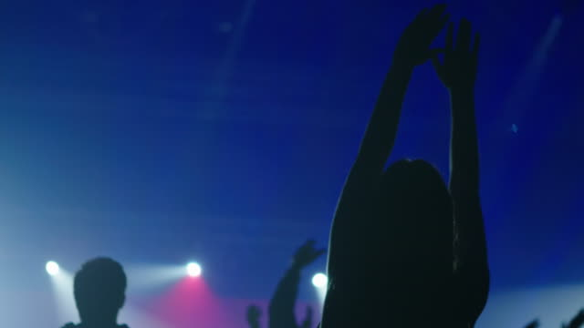Girl at concert hands in the air