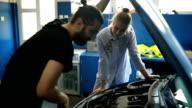 Girl at the mechanic
