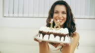 Girl Blowing Birthday Cake Candles 18 (HD Video)