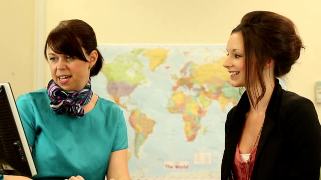 Girl booking a holiday at Travel agents - Dolly