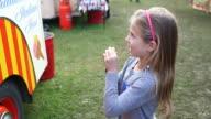 Girl buying ice cream