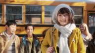 Girl by school bus