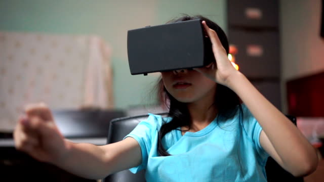 Girl catch something with Virtual Reality Headset