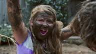 Girl celebrating her mud face - CU Coverage