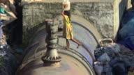 MS TD PAN HA Girl climbing water pipe and carrying bucket of water on head, Mumbai, Maharashtra, India