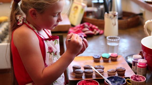 MS Girl decorating cupcakes / Lamy, New Mexico, United States