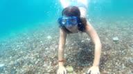 Girl diving underwater