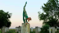 Girl does handstand and twine exercise