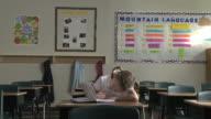 girl doing homework at school