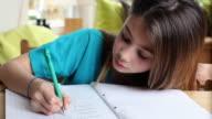 CU Girl (8-9) doing homework / Brussels, Brabant, Belgium