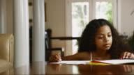 MS Girl (12-13) doing homework on dining table / Edmonds, Washington State, USA
